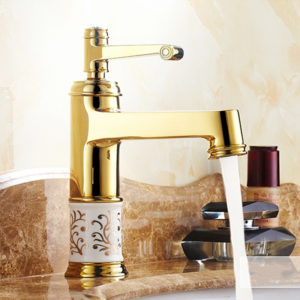 Europeiska klassiska gyllene badrumskåpkran het